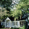 photo of house shaded by large trees, courtesy of National Renewable Energy Lab