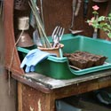 Gardening tools on a rustic workbench