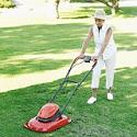 Woman using electric mower