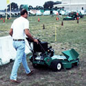 A man with a mulching lawn mower