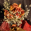 An arrangement of dried roses and babies breath