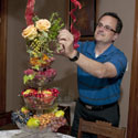 Mississippi State Extension professional making holiday arrangement