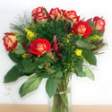 Bouquet of roses and greenery in vase