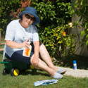 Lady applying sunscreen before gardening