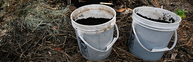 Two buckets of compost