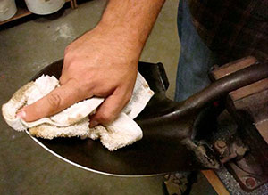 Oiling down the shovel blade