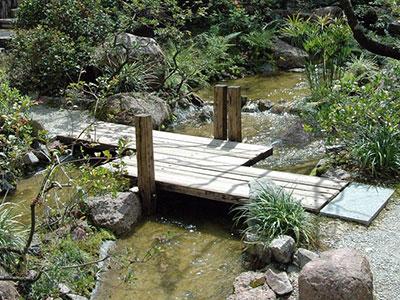 Water gardens gardening solutions university of for Metal garden bridge designs