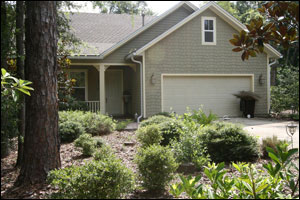 A nice home with a Florida-Friendly yard of mulch and trees and shrubs but no turfgrass