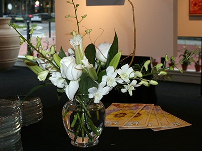 An arrangement of various flowers that are all white