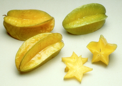 three whole carambola fruit and three slices showing the star shape, photo by Florida Department of Agriculture and Consumer Services