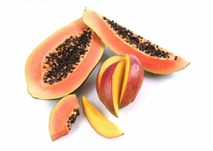 colorful papaya fruit cut open to show hundreds of small black seeds