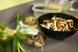 Mushrooms in a wooden bowl on a kitch counter