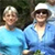 Two smiling women in blue shirts