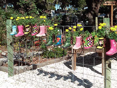 rain boots being used as planters
