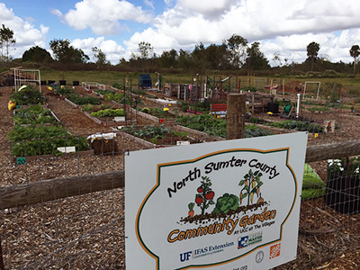 a view of the North Sumter County Community Garden including a sign