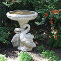 Concrete birdbath decorated with swans