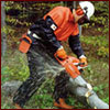 Man using chain saw safely