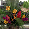 Holiday arrangement with palm fronds and dried fruit