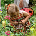 Little girl in butterfly garden