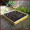 raised bed divided into sixteen squares