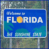 Blue highway sign that reads Welcome to Florida, the Sunshine State