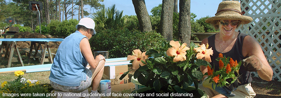 Women volunteering in a garden - photo was taken prior to national guidelines on masks and social distancing