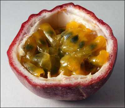 A passion fruit open to show seeds