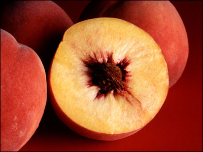 Peach cut open to reveal pit