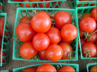 Cherry tomatoes in baskets